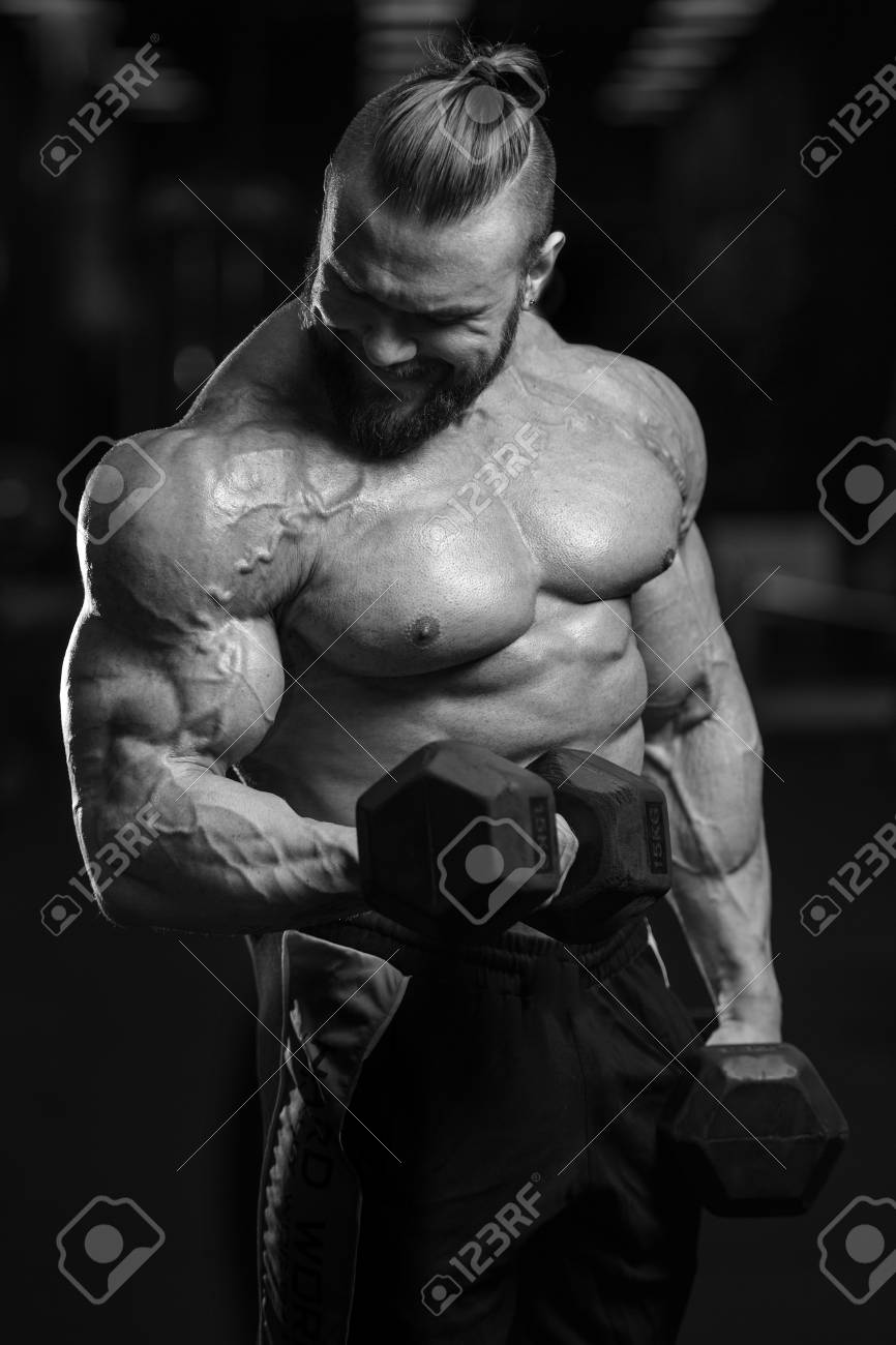 Handsome Power Athletic Man On Diet Training Pumping Up Muscles ...