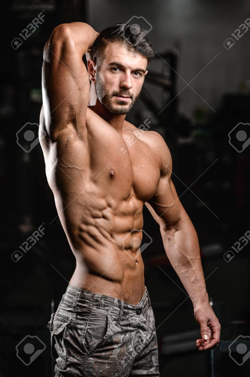 best service 30e3f 735f3 Handsome caucasian sexy fitness model in gym close up abs concept..