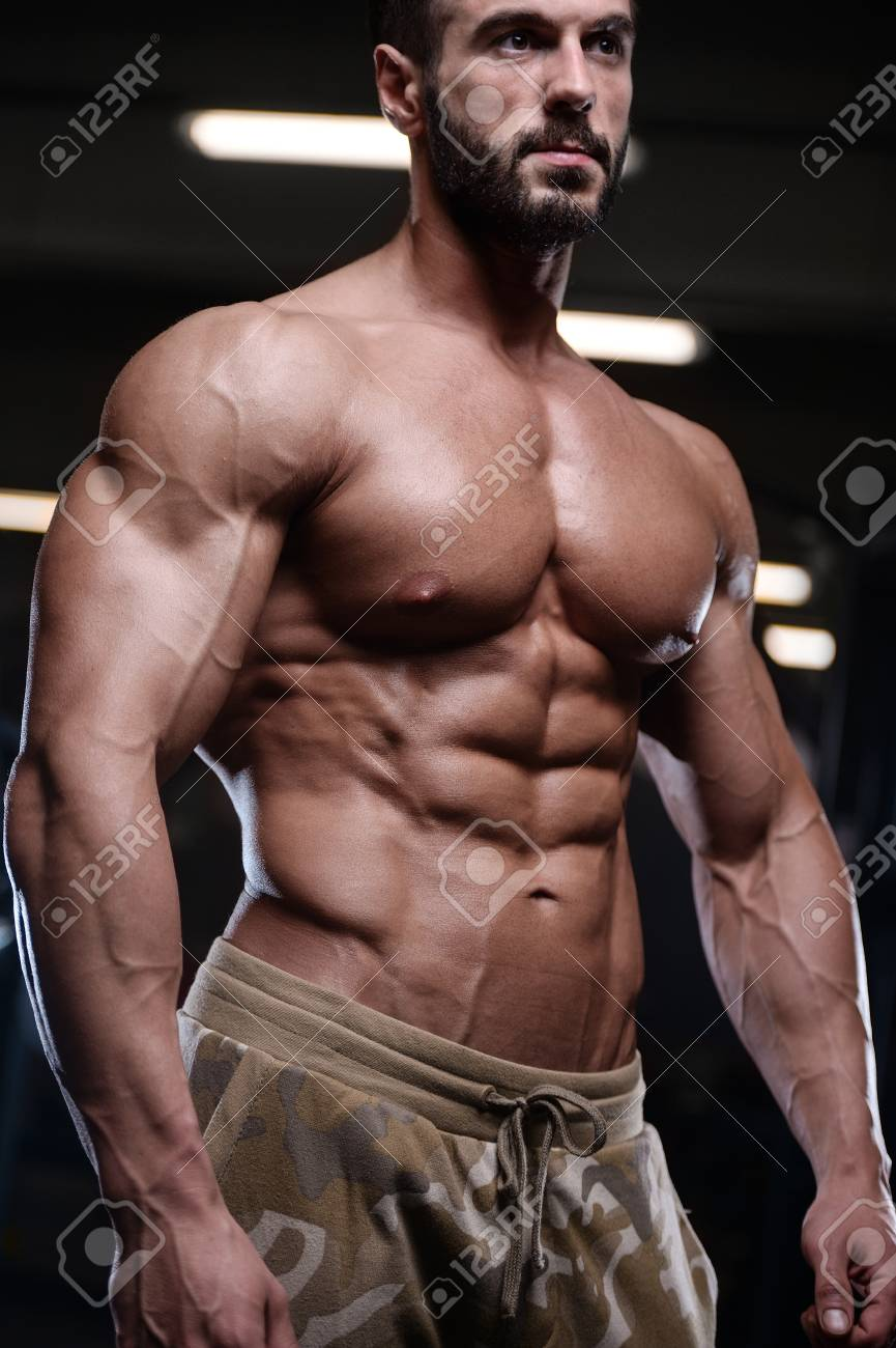 Sexy Strong Bodybuilder Athletic Fitness Man Pumping Up Abs Muscles Stock Photo Picture And Royalty Free Image Image 91987656