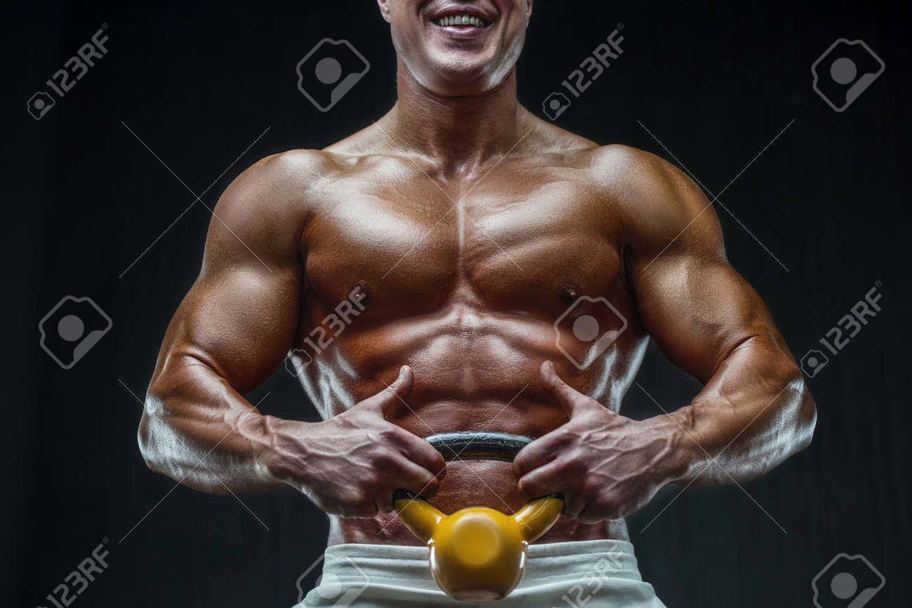 fit man training training abs muscles at gym. Pumping up abdominal exercise. Close up muscles at workout. Bodybuilding, fitness and health care concept. - 167141225