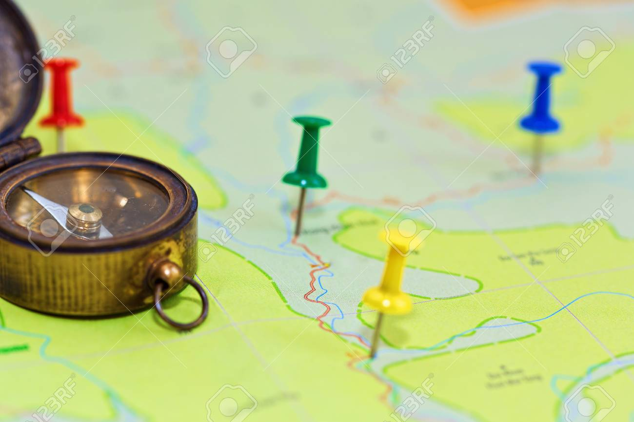 Colored pins in map symbolizing the route of journey in close-up