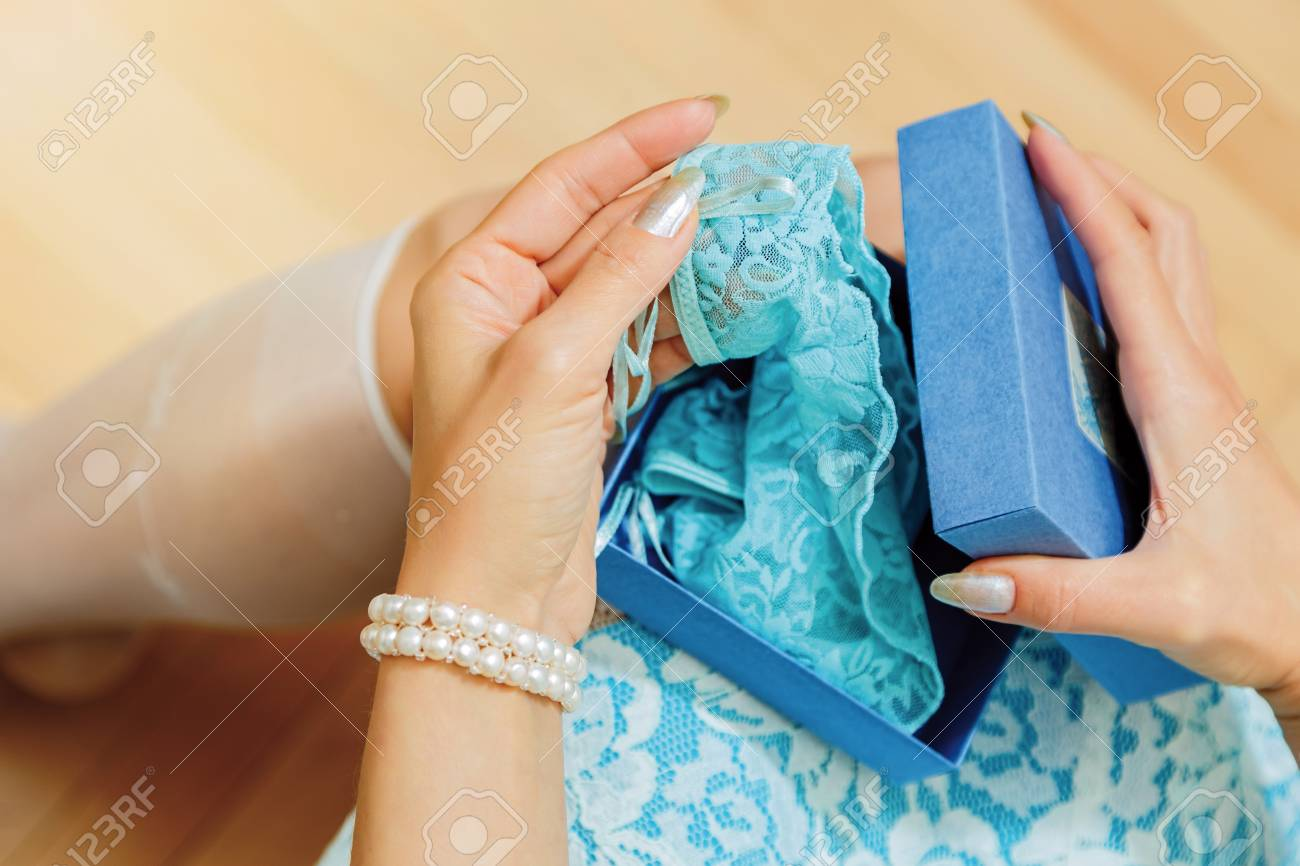 Young Adult Female Person Opens A Gift Box And Get Sexy Blue