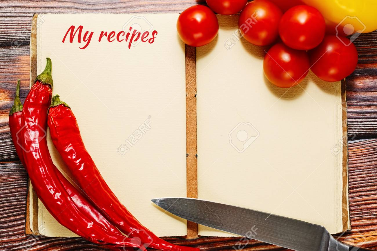 Opened vintage recipes book with empty pages with hot spicy chili opened vintage recipes book with empty pages with hot spicy chili pepper and tiny cherry tomatoes forumfinder Choice Image