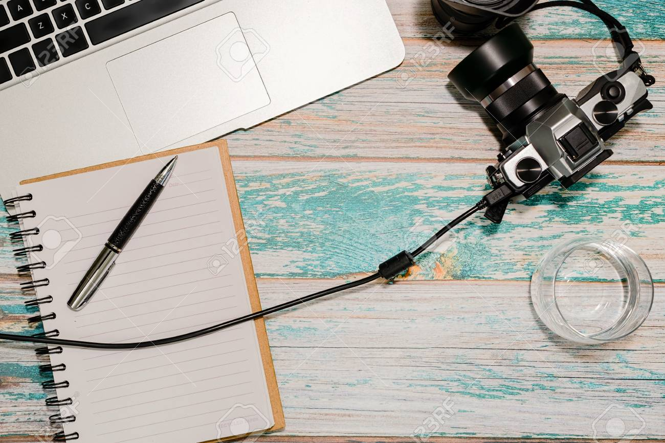 Photographer Workspace - Laptop, Vintage DSLR Camera Wired To ...