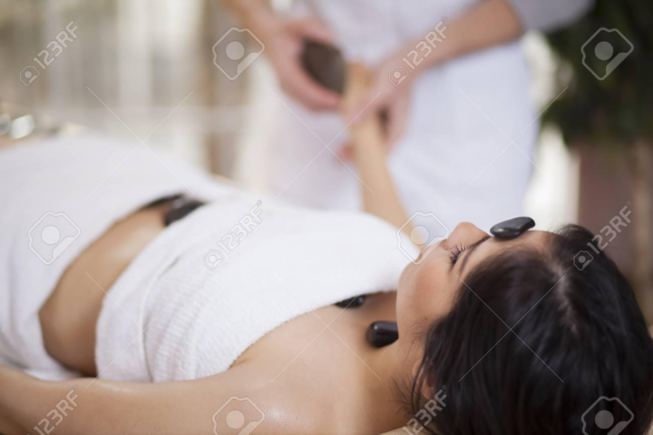 Pretty young woman getting a stone massage at a spa Stock Photo - 18183596