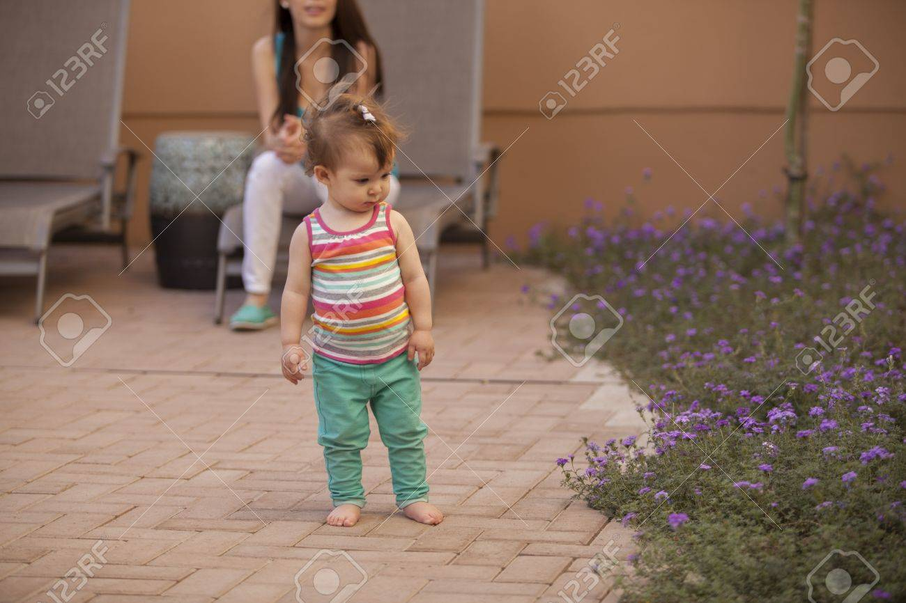 Beautiful baby girl and her mom spending time outdoors Stock Photo - 18635585
