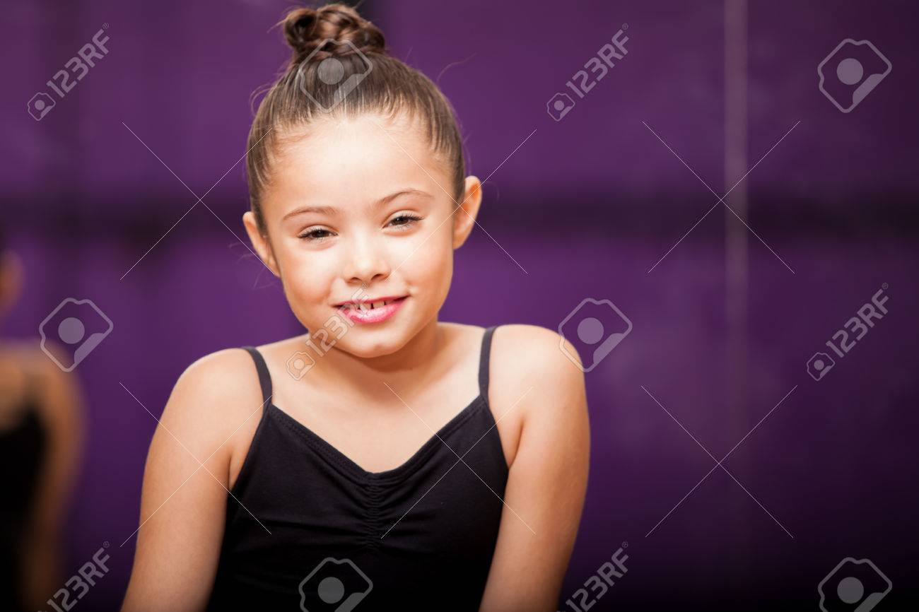 974deb75e87f Portrait Of A Beautiful Little Girl Wearing A Ballet Outfit And ...
