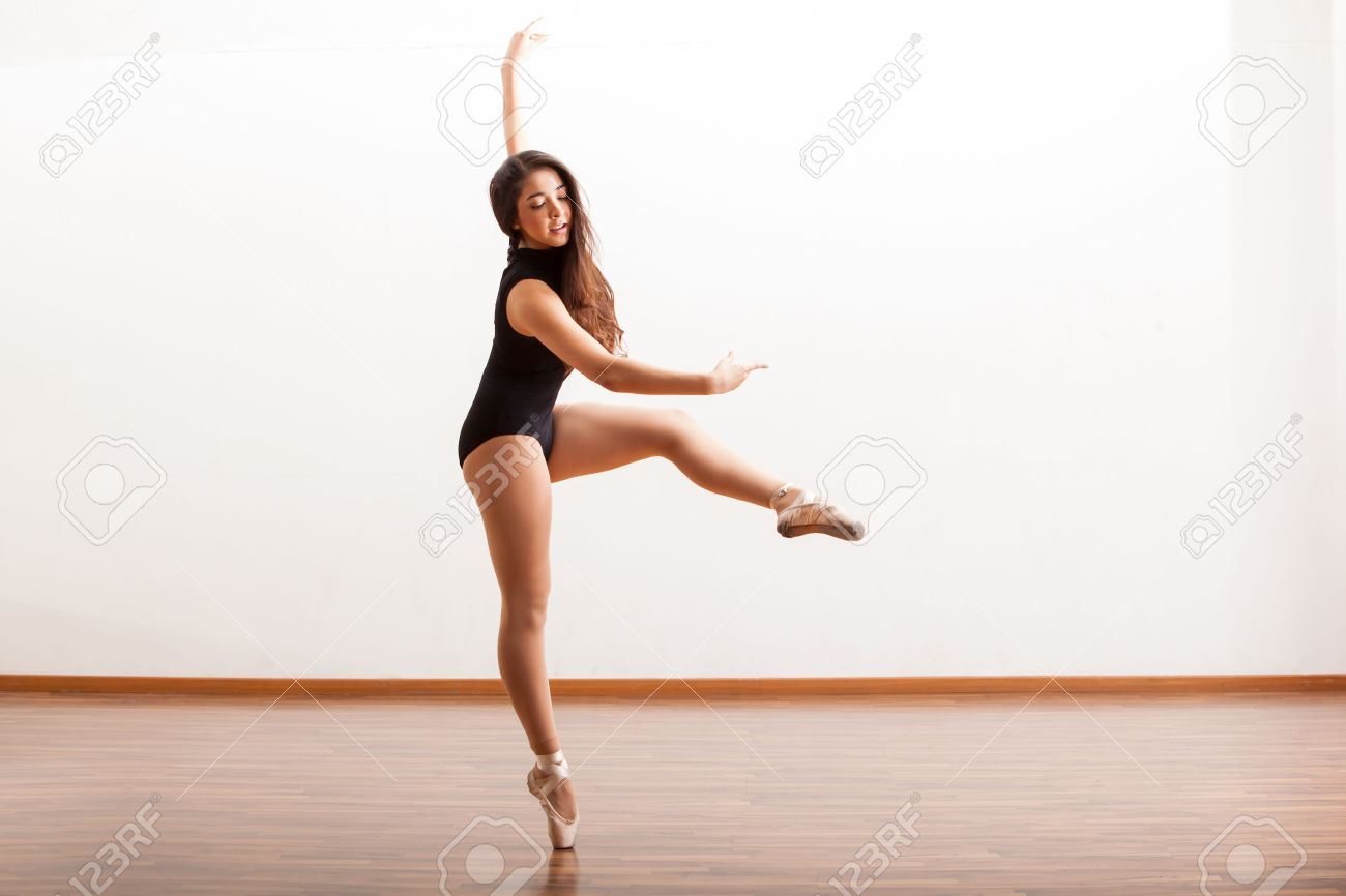 Sexy female ballet dancer during a dance routine in a dance studio