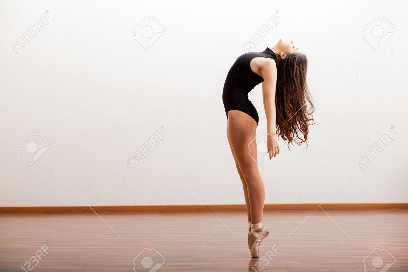 Gorgeous ballet dancer maintaining balance during a dance routine