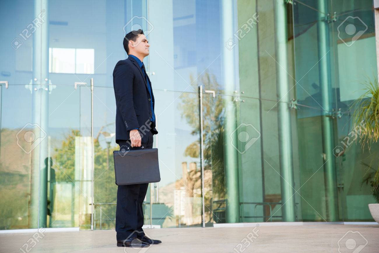 good looking man in a suit and carrying a briefcase about to good looking man in a suit and carrying a briefcase about to have a job