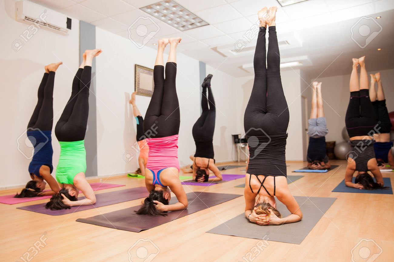 Image result for image of people doing headstands