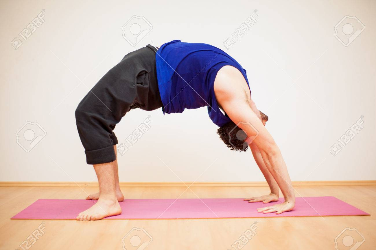 Portrait Of A Young Man Doing A Backbend Pose In A Yoga Studio Stock Photo Picture And Royalty Free Image Image 42872156