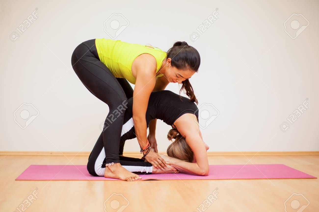 Female Yoga Instructor Helping A Student With A Backbend Pose Stock Photo Picture And Royalty Free Image Image 42872250
