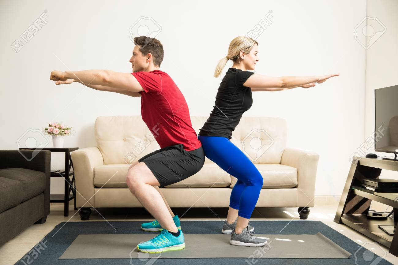Profile view of a young Latin couple exercising and doing some