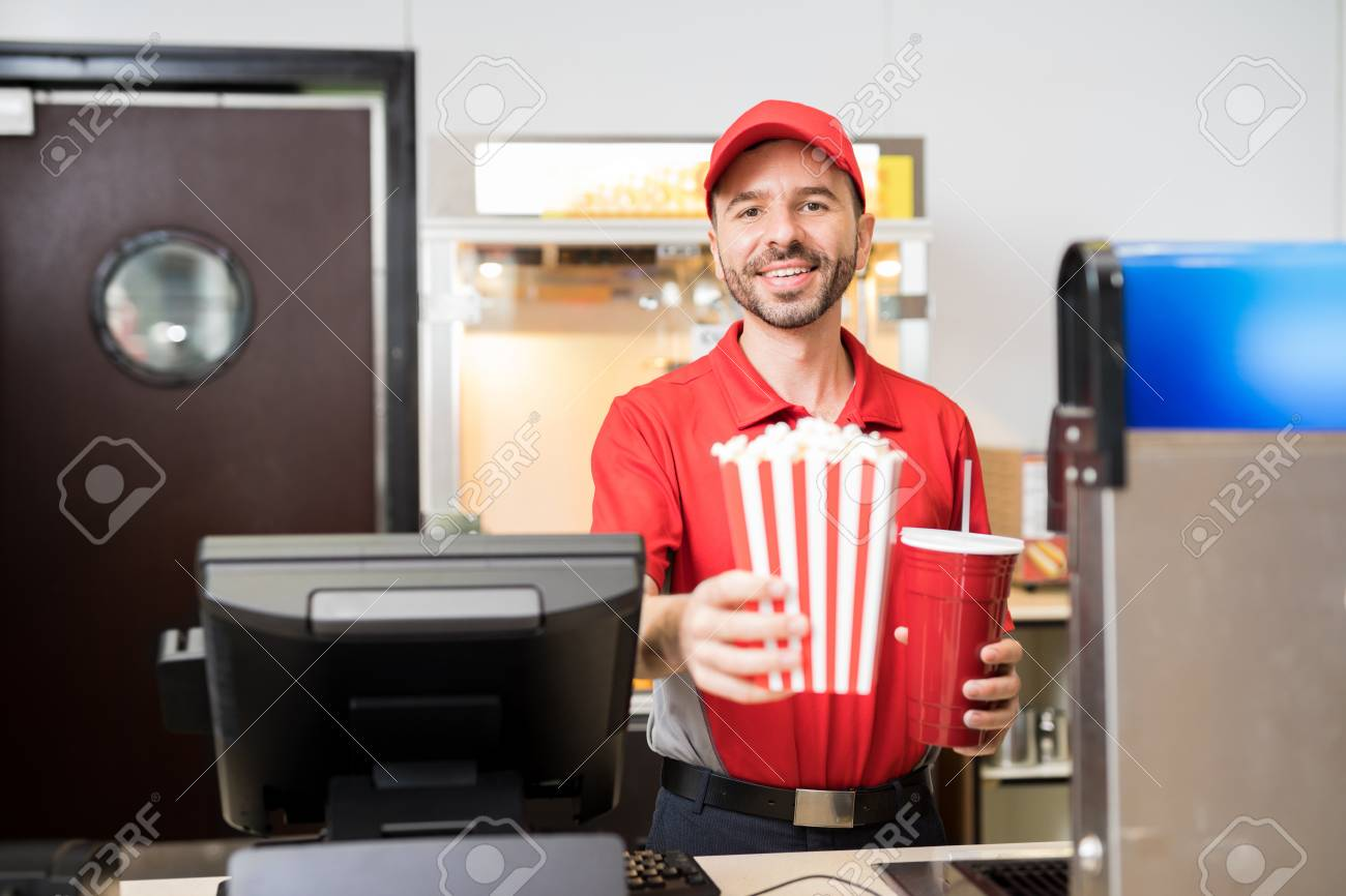Portrait Of A Male Worker In Uniform Selling Popcorn And Soda Stock Photo Picture And Royalty Free Image Image 82916849