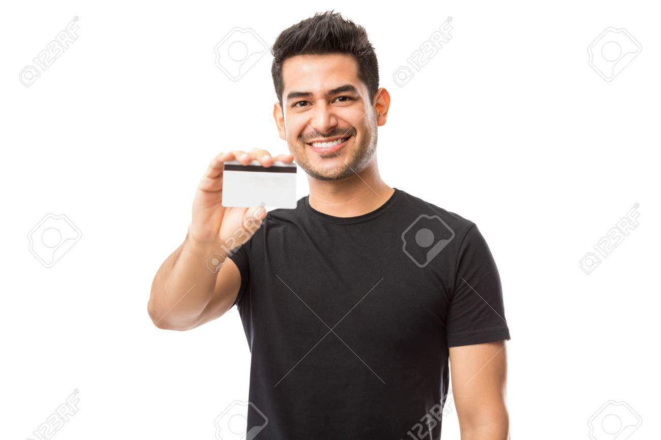 Attractive guy promoting credit card while standing against white background - 108974078