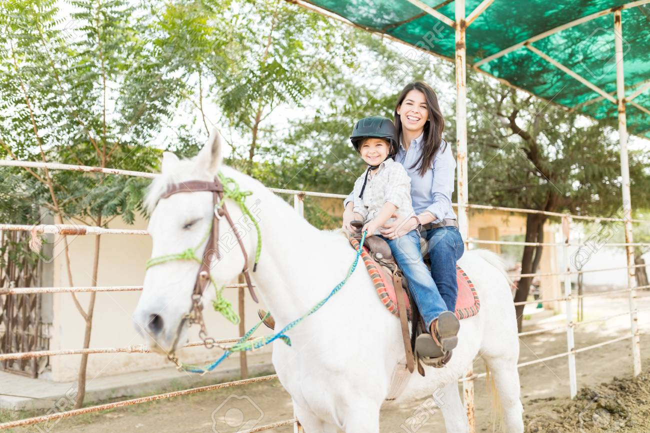 Portrait Of Happy Mother And Daughter Riding White Horse At Farm Stock Photo Picture And Royalty Free Image Image 114080023