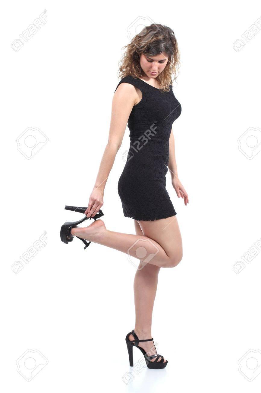 Beautiful Woman Wearing A Black Dress Putting On Or Taking Off