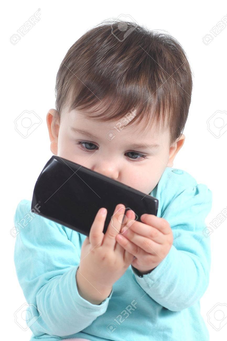 Casual baby watching attentive a mobile phone isolated on a white background Stock Photo - 19525401