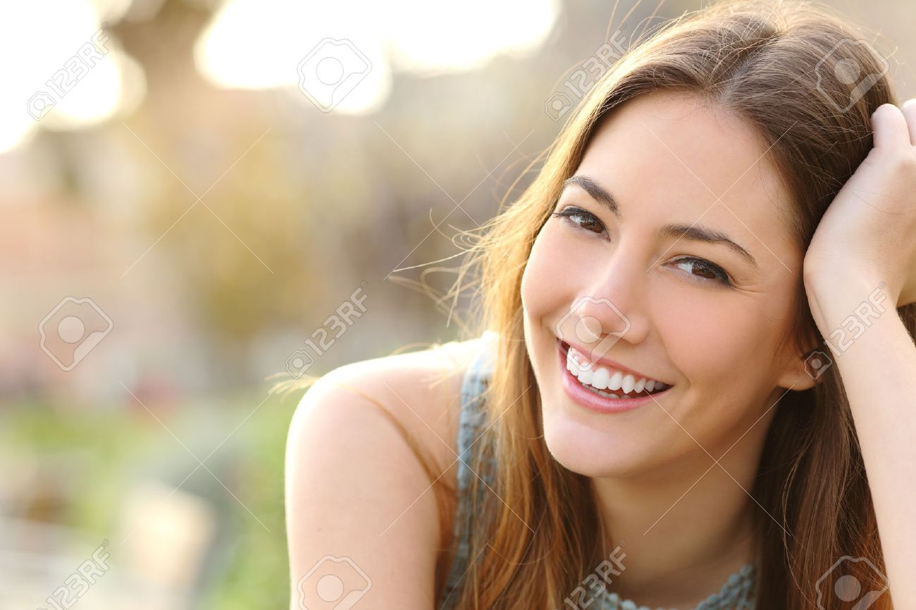 Stock Photo Woman Smiling With Perfect Smile And White Teeth In A Park And Looking At Camera