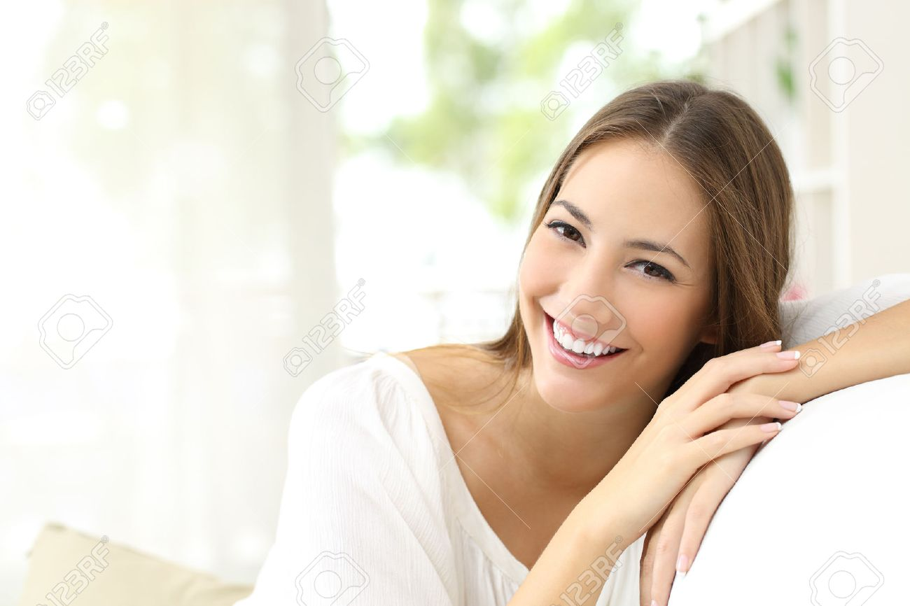 Beauty woman with white perfect smile looking at camera at home Stock Photo - 50532393