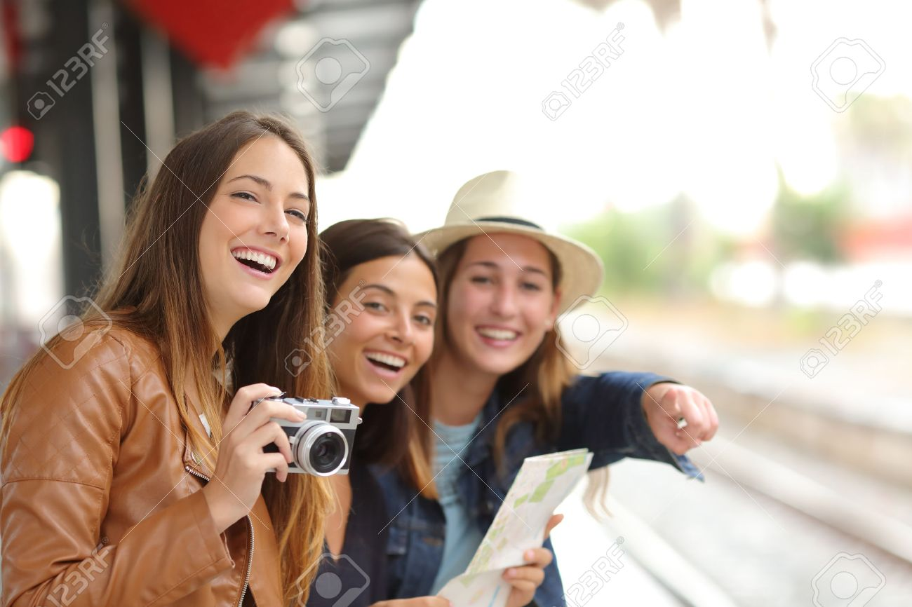Group of three traveler girls traveling and waiting in a train station platform - 54069520