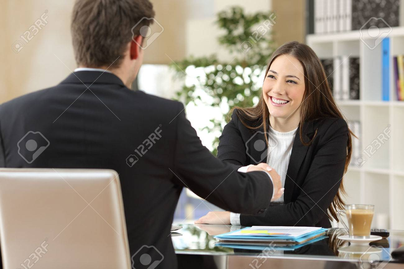 Businesspeople handshaking after negotiation or interview at office - 65460876