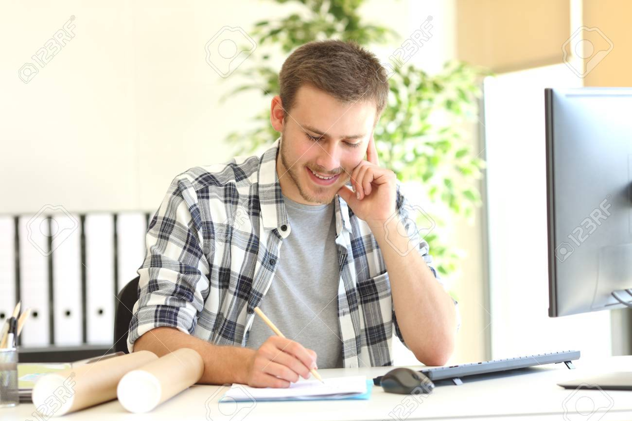 Designer Or Architect Working Writing Notes At Office Stock Photo   68710787