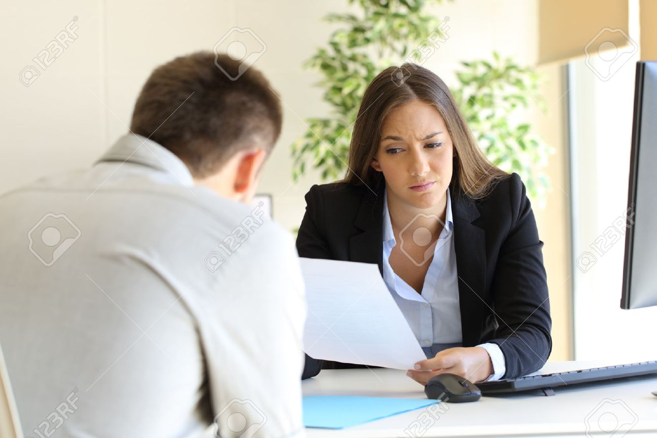 businesswoman reading a bad resume in a job interview stock photo