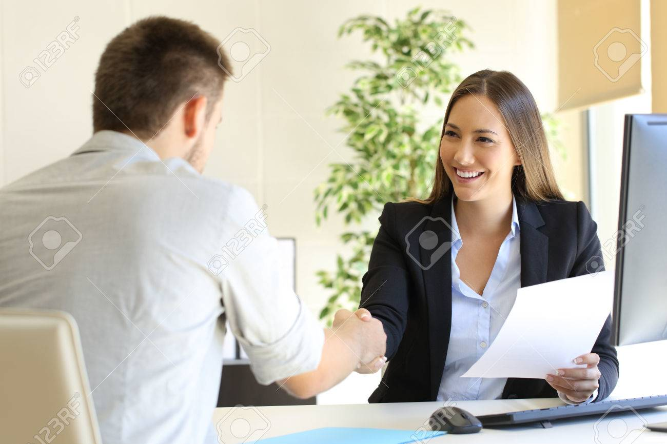 Successful job interview with boss and employee handshaking - 69027595