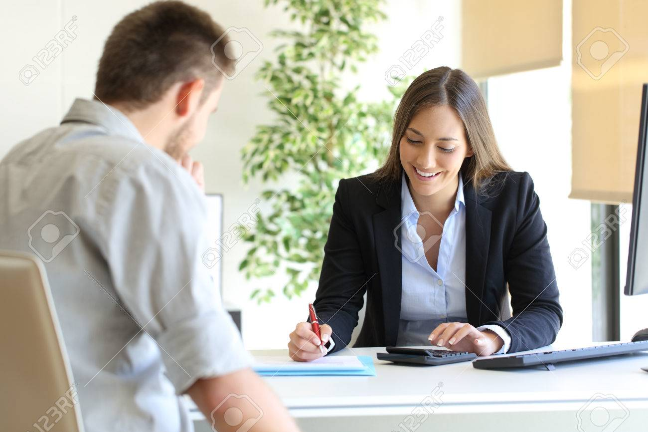 Happy professional agent and customer calculating budget at office - 69027500