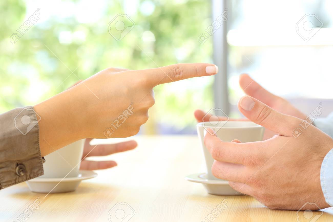 Close up of couple hands arguing on a table at home or coffee shop - 86541745
