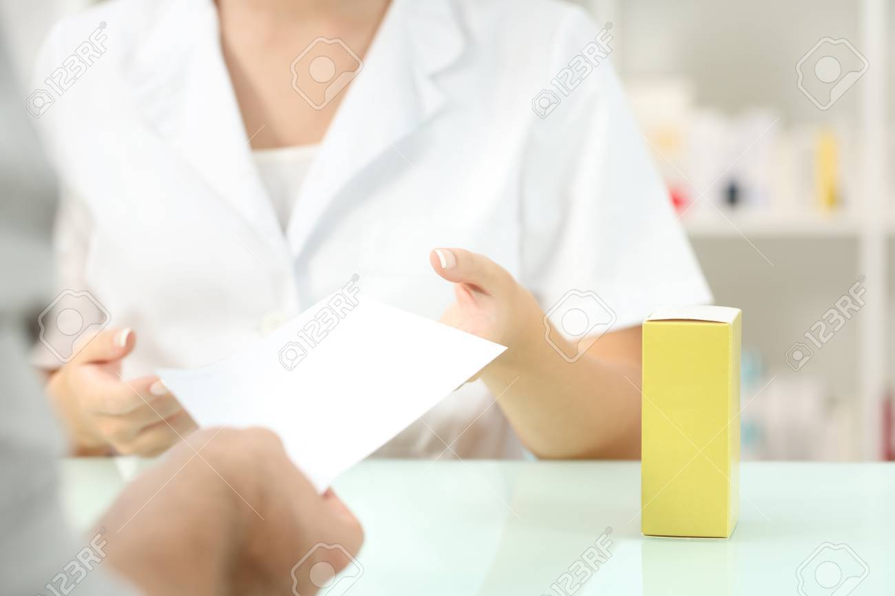 Close up of a customer giving recipe to a pharmacist requesting medicines in a pharmacy interior - 88707734