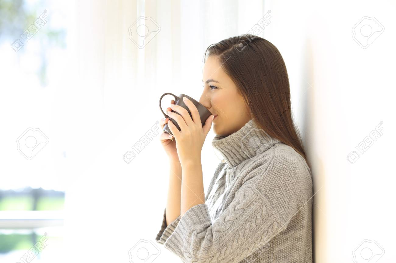 Side View Portrait Of A Woman Drinking Coffee Looking Through.. Stock  Photo, Picture And Royalty Free Image. Image 90069674.