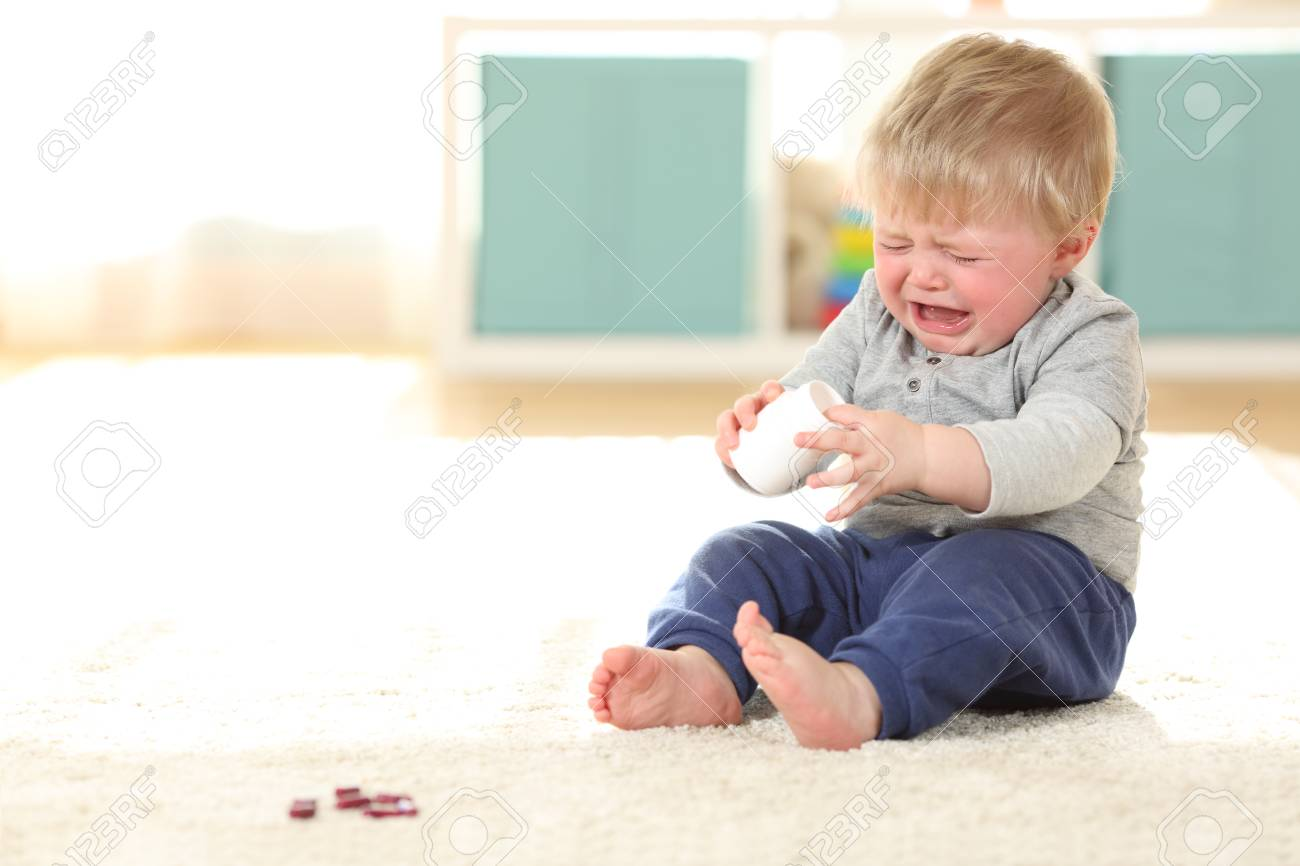 Sad Baby Crying In Danger After Eating Some Pills From A Bottle On The  Floor At