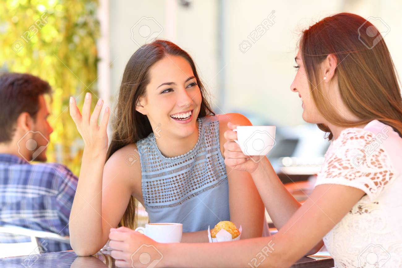 Two happy friends talking and drinking in a coffee shop terrace - 115370481