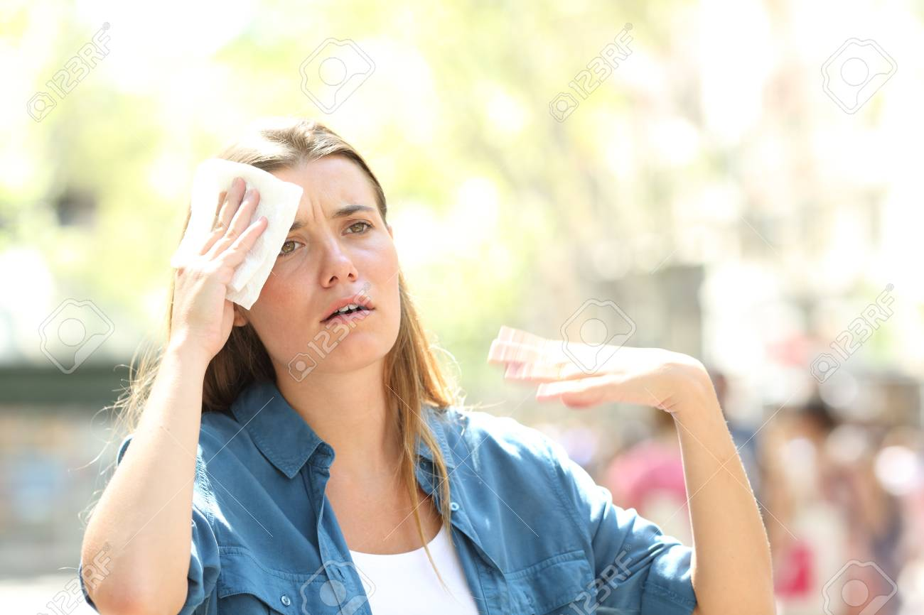 Unhappy Woman Sweating Suffering A Heat Stroke And Fanning With.. Stock  Photo, Picture And Royalty Free Image. Image 123603245.
