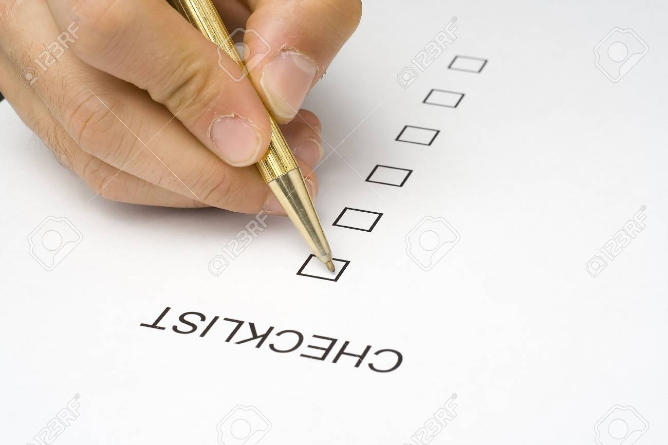 businessman filling out a questionnaire quality of service Stock Photo - 3713611