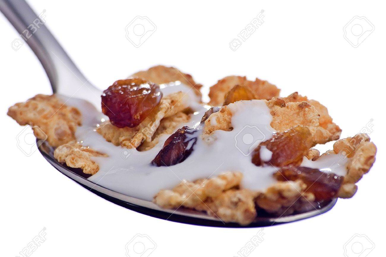 bowl of cereal with raisins and milk isolated Stock Photo - 4147137