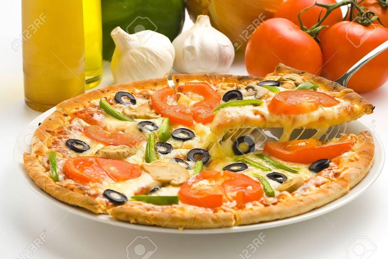 homemade pizza with fresh tomato olive mushroom cheese isolated Stock Photo - 4512907