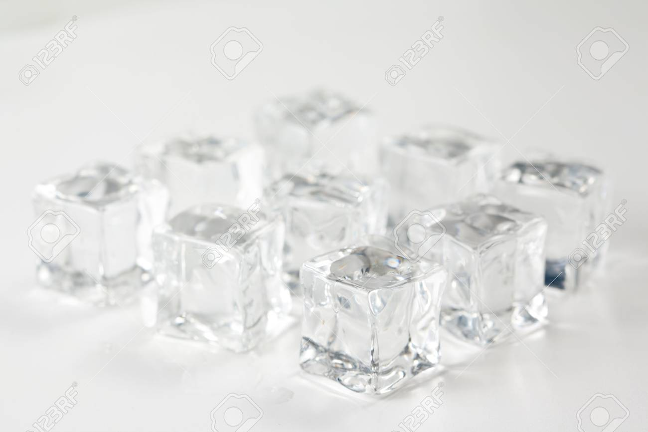 translucent ice cube isolated over white background Stock Photo - 6715536