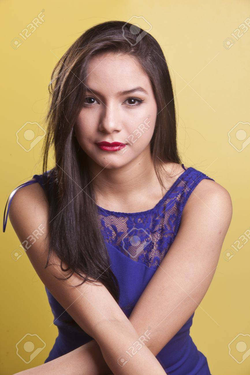 sexy latina model in a blue dress on a yellow background Stock Photo - 13770451