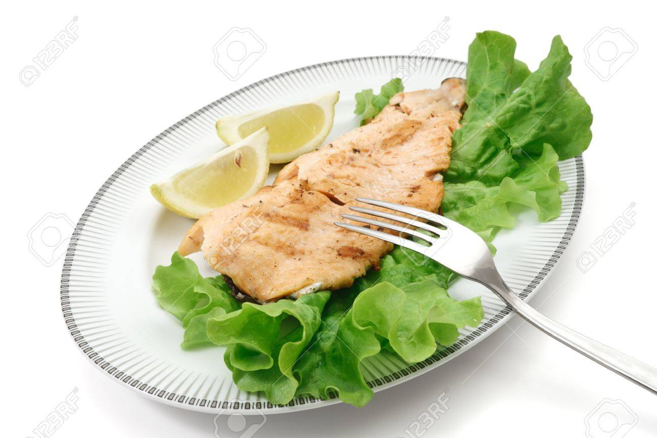 plate with grilled salmon trout, lettuce isolated on white Stock Photo - 9036814
