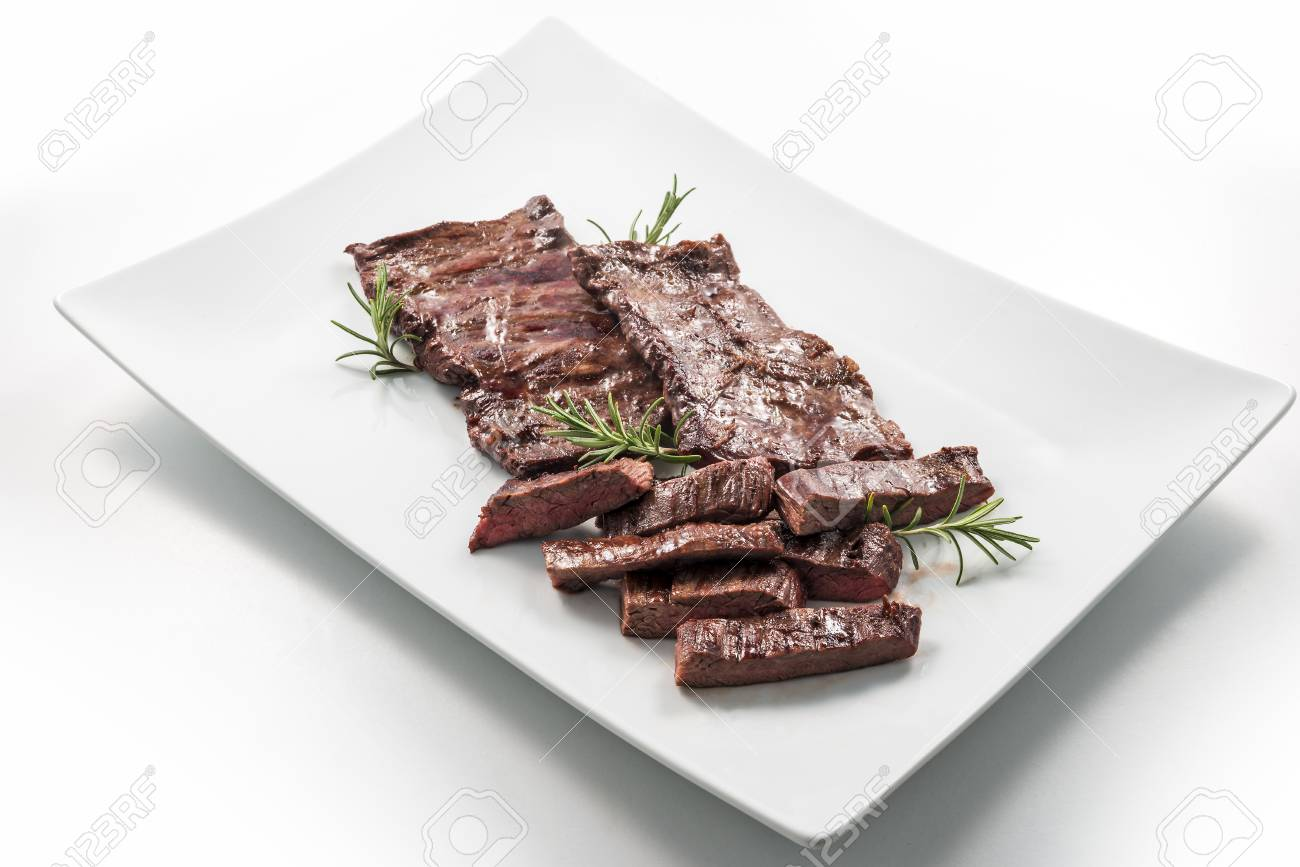 Square White Plate Of Sliced Skirt Steak And Rosemary Stock Photo Picture And Royalty Free Image Image 102682542