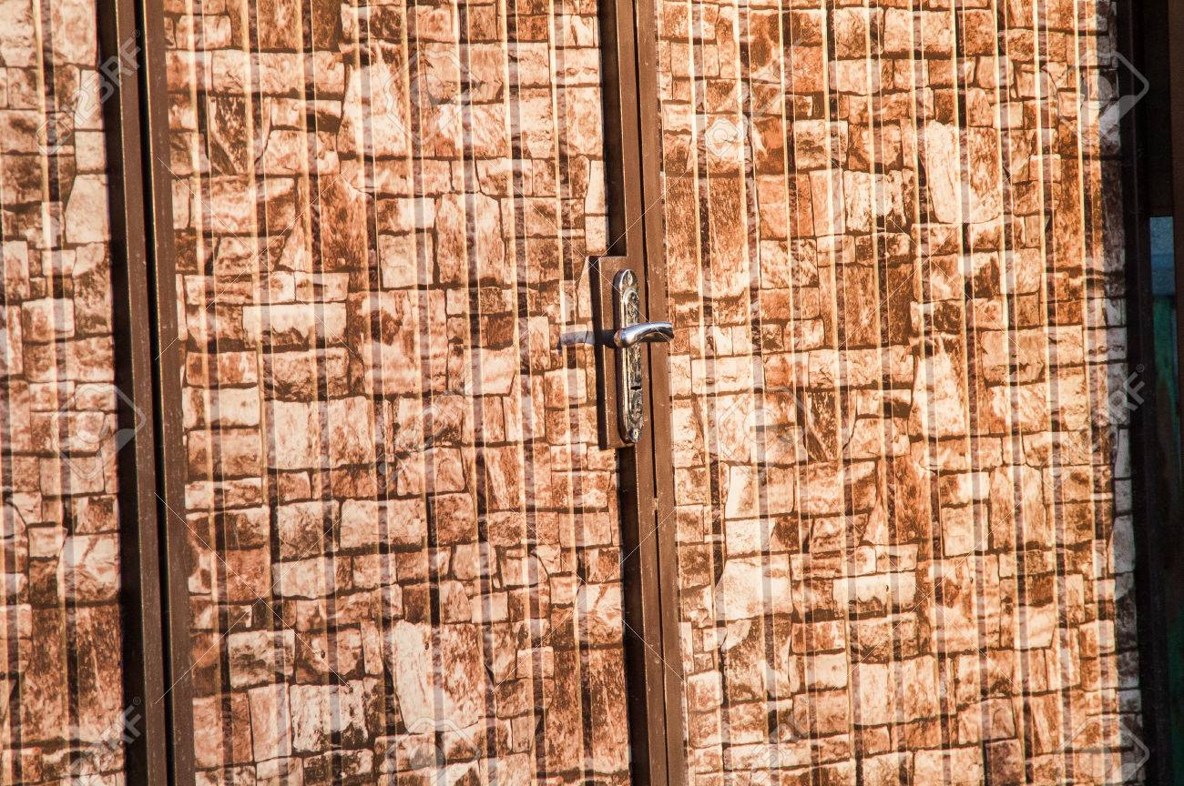 Decorating wicket door images : Brown Camouflage Wicket Door In The Fence Stock Photo, Picture And ...