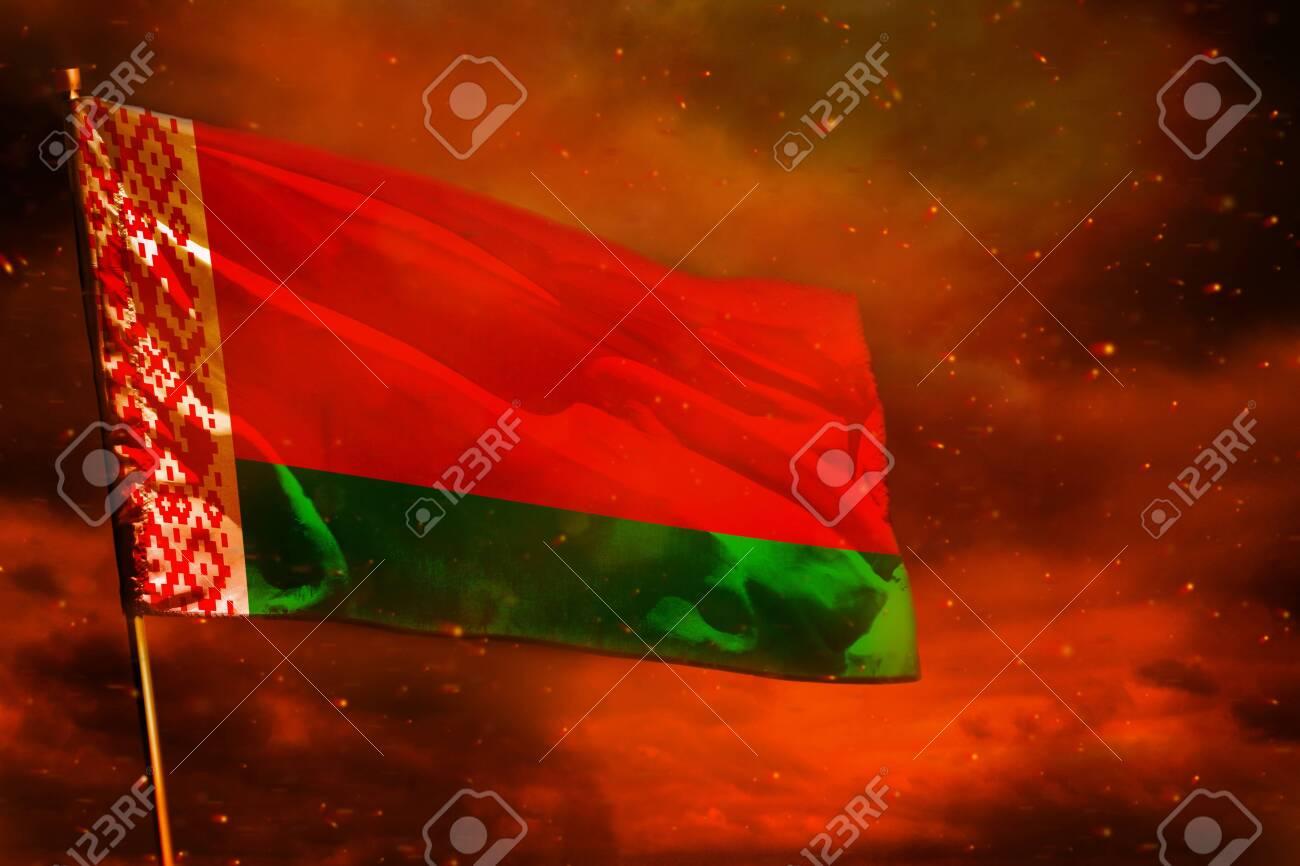 Fluttering Belarus flag on crimson red sky with smoke pillars background. Belarus problems concept. - 123011527
