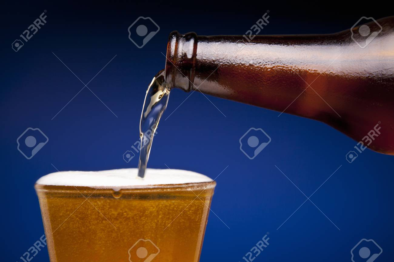 Beer is being poured in a glass. Stock Photo - 22224446