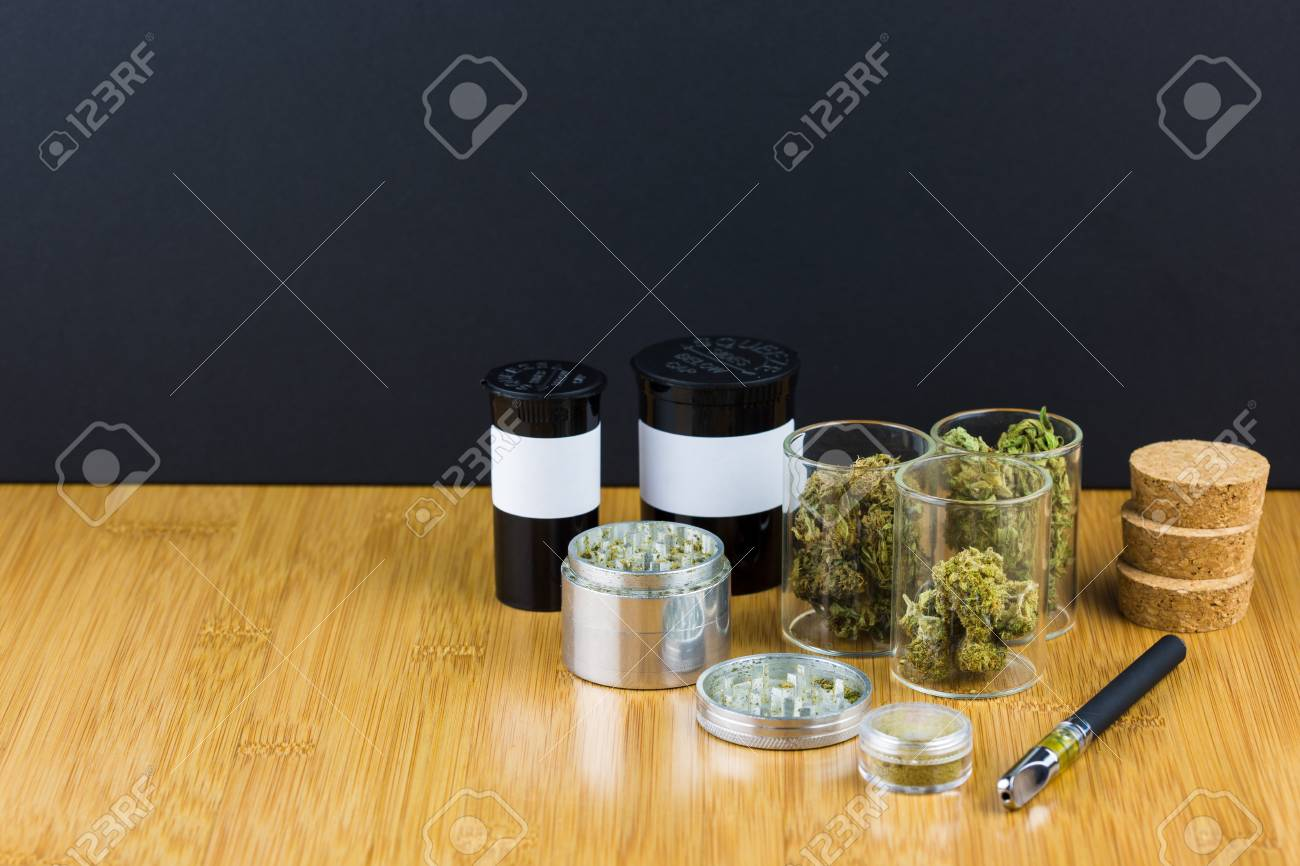 assorted medical marijuana in glass jars and containers with stock
