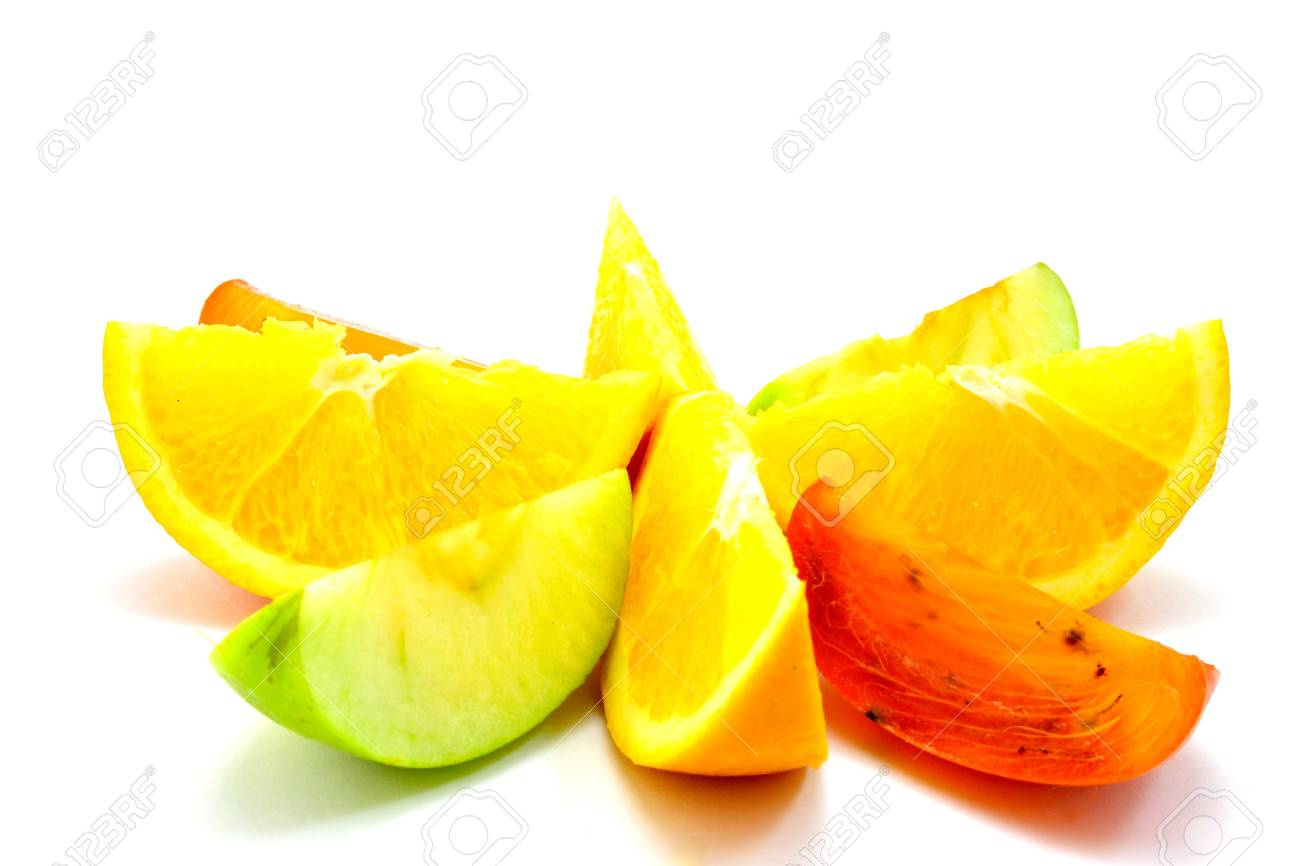 bright fruit slices lie around on a bright white background Stock Photo - 16886817