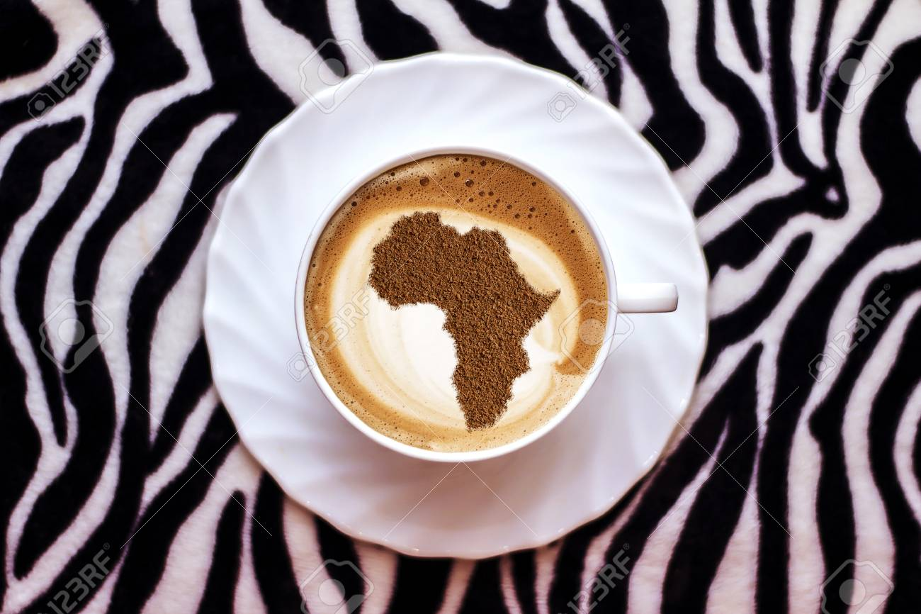 cup of coffee cappuccino with a picture of africa on milk foam